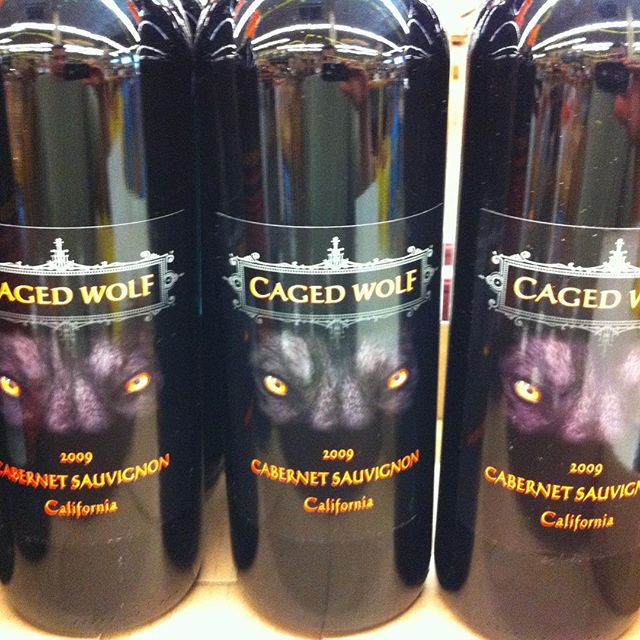 Day 27 of 31 Days of Halloween wine labels.  The Caged Wolf makes an appearance. You will be howlin' for this California Cab ⠀.⠀ #halloween #halloweenwine #halloweenwinelabels #holidaywine #wine #wine #wines #winelife #wineoclock #vino #winepic #winetime #winelover #winestagram #winegram #wineplease #winepics #wineday #instawine #winelabel #winelabels #winebottle #winebottles